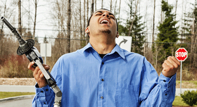 Image of an enraged man at a fuel pump