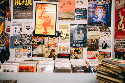 A wall of gig posters in a record shop