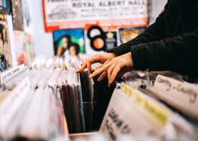 A person browsing records in a shop