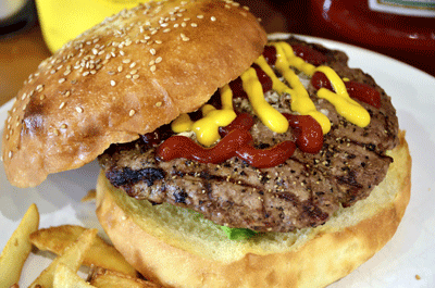 Image of a burger with ketchup and mustard
