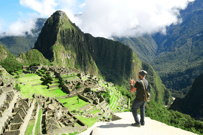 A man standing in front of Machu Picchu