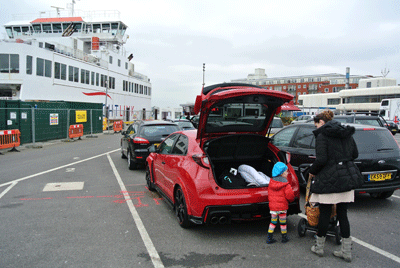 Image of family queuing for ferry