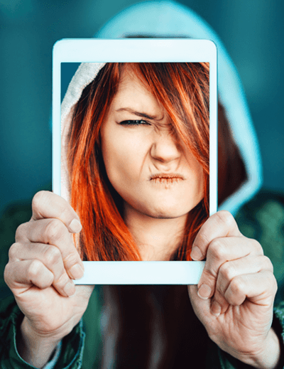 Image of a woman taking an angry selfie