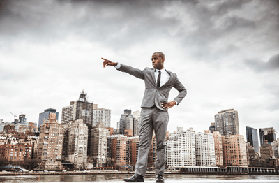 Image of a dapper man pointing majestically off into the distance