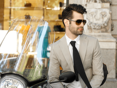 A businessman with a scooter