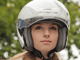 Woman in a motorcycle helmet