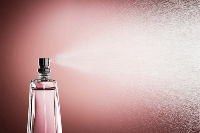 Image of perfume being sprayed