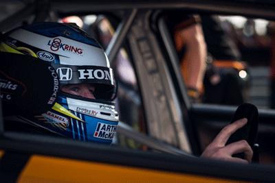 Image of BTCC driver in car
