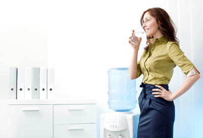 Image of a woman looking joyful at a water cooler