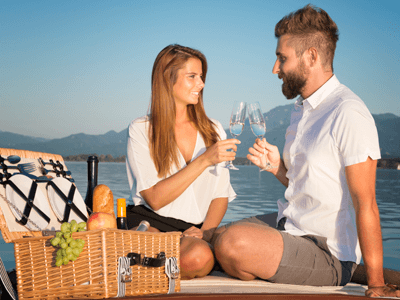 A couple enjoying a picnic on deck on a ferry