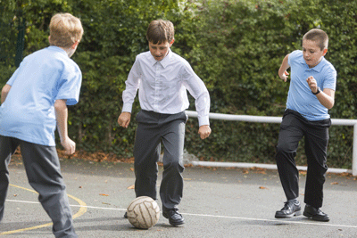 Image of schoolboys playing football