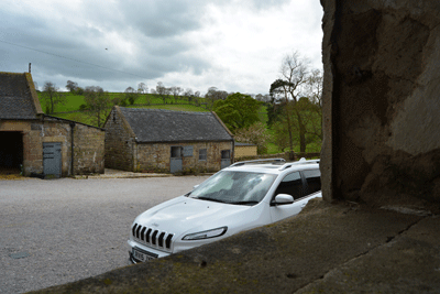 Image of a Jeep Cherokee on a farm