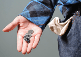 A person holding spare change from their pocket