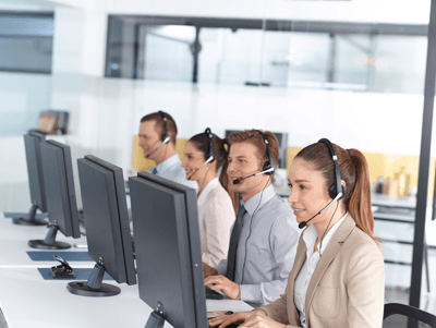Image of happy workers at a call centre