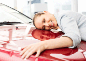 Image of a woman embracing a car