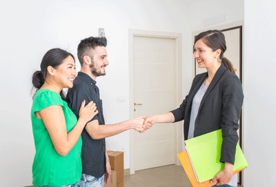 Image of an estate agent shaking hands