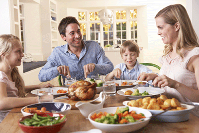 Image of a family enjoying a roast