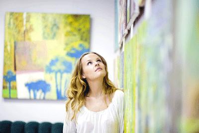 Image of woman looking at art