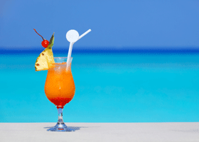 image of a cocktail on a beach