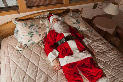 Image of a santa chilling out having a lie down