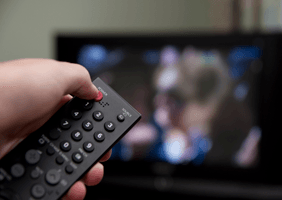 Image of someone using a remote control