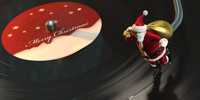 Image of a santa figurine on a record player