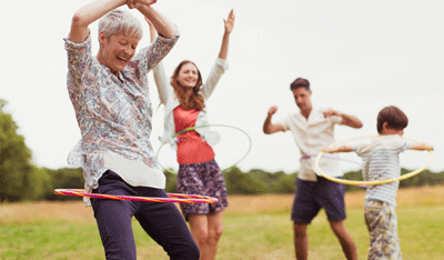Image of a family hula hooping