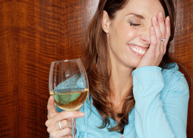 Image of a woman with a glass of wine