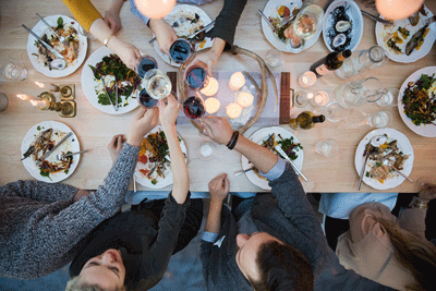 Image of a table with wine and food
