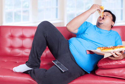 Image of a man eating pizza