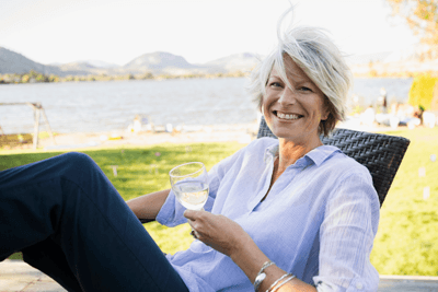 Image of a woman looking jolly with wine