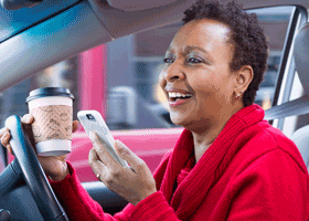 Image of woman driving on phone