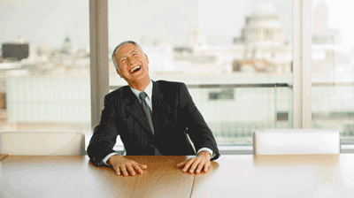 Image of a boss laughing