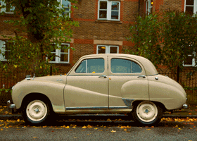 Image of a morris minor parked up