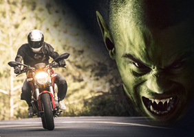 A biker being chased by a demon