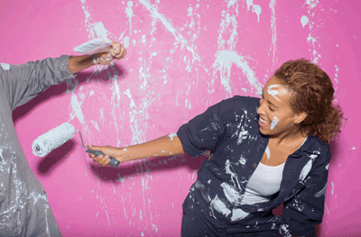 Image of a couple fighting with paint