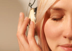 Image of woman listening to music