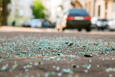 Image of smashed glass on road