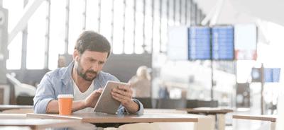 Image of a man checking insurance at airport