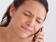 Woman wincing on the phone