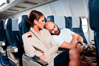 Image of man sleeping on woman's shoulder