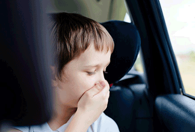 Image of a child about to be car sick