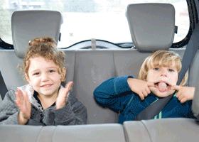 Image of bratty kids in a car