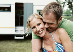 Image of couple enjoying caravan