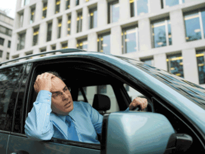 Image of a frustrated man in a car