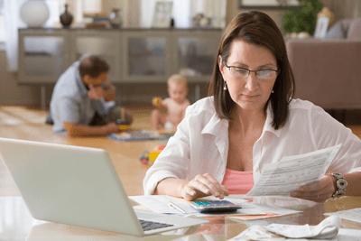 Image of woman checking bills