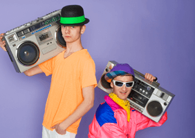 Image of boys dressed in 80s outfits