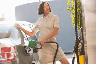 Image of woman at petrol station