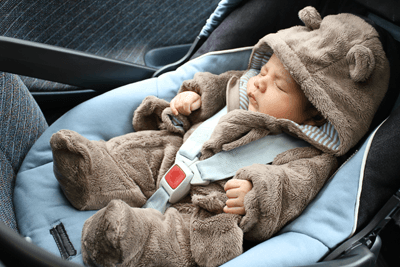 This is a photo of a newborn baby dressed as a teddy bear