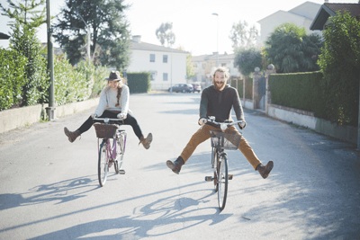 Image of couple on bikes